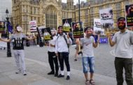 Activists stage anti-Saudi protest in London as Qatari emir arrives for talks