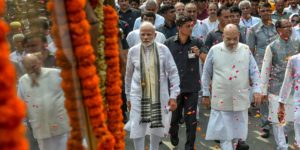 PM Narendra Modi and BJP chief Amit Shah walk along Vajpayee​'s funeral procession